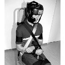 Detainee being bound to a chair for the deportation. Picture from the training material of the Zurich police.